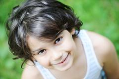 Closeup portrait of a little kid in nature Stock Photos