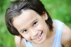 closeup portrait of a little kid in nature - stock photo