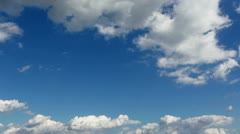 Time lapse clip of white fluffy clouds over blue sky - stock footage