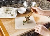 Making asian spring rolls for dinner Stock Photos