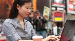 Woman Using Laptop in Timesquare - stock footage