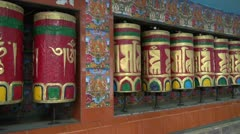 beautiful Tibetan buddhist prayer wheels in Dharamsala, India - stock footage