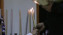 Lighting Chanuka candles Stock Footage