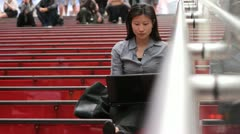 Woman Using Laptop on Red Steps Stock Footage