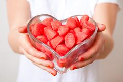 Woman with red sweets Stock Photos