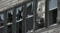 Broken Windows and Flapping Burlap in Abandoned Building Stock Footage