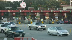 Toll booth in the evening commute traffic Stock Footage