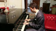 Stock Video Footage of Man Playing Piano