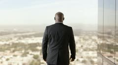 African American businessman holding arms out wide and looking upward Stock Footage