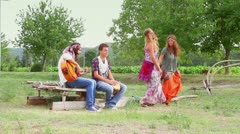 Hippie Group Playing Music and Dancing Outside Stock Footage