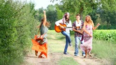 Hippie Group Playing Music and Dancing Outside - stock footage