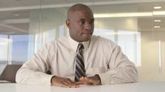 African American businessman drumming on desk Stock Footage
