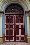 decorated door of a church. - stock photo
