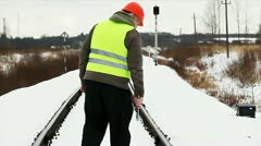 Worker with adjustable wrench on railway Stock Footage