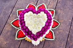 Stock Photo of flower art in a shape of a heart for wedding ceremony