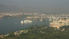 Landscape with lake and palaces in Udaipur India Stock Footage