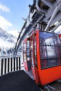 Stock Photo of red cable car in winter
