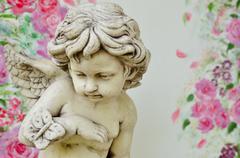 Vintage cupid sculpture - stock photo