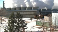 130212 powerplant smoke stacks with coal train pulling up Stock Footage