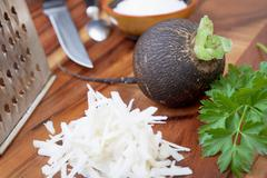 black radish rub on a small grater - stock photo