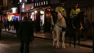 London Police on Horses at night Stock Footage