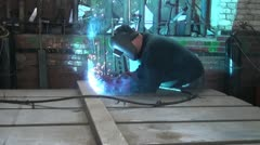 Welder working hard at the plant Stock Footage