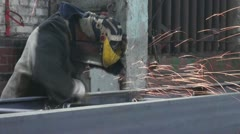 Sparks from the circular saw in the hands of of the worker Stock Footage