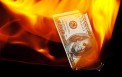 Burning Hundred Dollar Bill Stock Photos