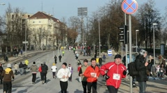 People take part in Christmas santa marathon run holidays event Stock Footage