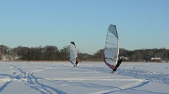 People ice sail surfing kiteboarder hobby winter lake Stock Footage