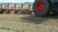 Stock Video Footage of tractor wheel plough closeup plow field harvest festival