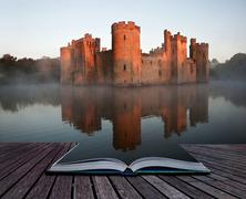 stunning moat and castle in autumn fall sunrise with mist over moat in pages - stock illustration