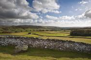 View across fields towards wharfe dale in yorkshire dales national park Stock Photos