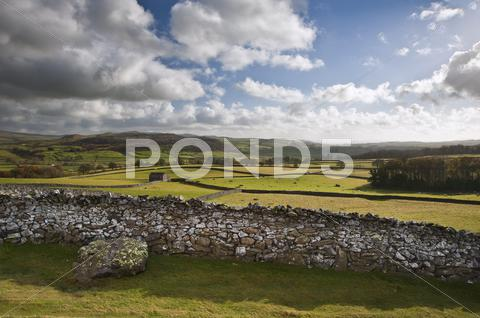 Stock photo of view across fields towards wharfe dale in yorkshire dales national park