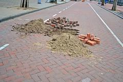 Brick road under repair, modern brick highway reconstruction. Stock Photos