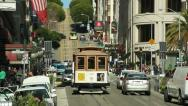 Stock Video Footage of San Francisco trolley cable car running on a street slope hill