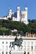 statue of louis xiv and basilique fourviere - stock photo
