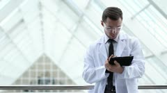 Scientist hands working on tablet computer Stock Footage