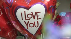 Stock Video Footage Love Balloon surrounded by Flowers and Roses High Definition Stock Footage