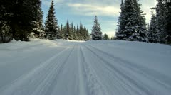 Snowy Road Driving POV - Corner - low angle Stock Footage