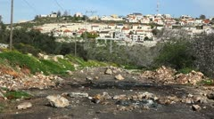 Road blocked with rocks after conflict between Jews and Arabs Stock Footage