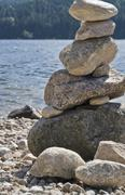 waterside scenery with pebble pile - stock photo