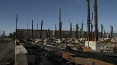 Charred Burnt Skeletal Remains of Industrial Building Disaster - pan Stock Footage