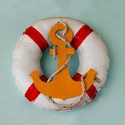 life buoy preserver on wall background - stock photo