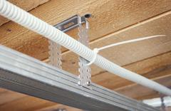 Electrical wiring in a suspended ceiling Stock Photos