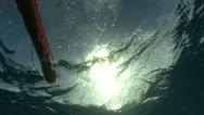 Diver ascends to surface with marker bouy Stock Footage
