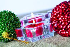 christmas baubles and candles - stock photo