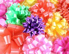 Close-up ribbon gift bow (red, pink, violet, yellow, green) Stock Photos