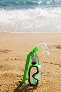 snorkel and mask in sand - stock photo