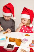 Girls decorating gingerbread cookies Stock Photos